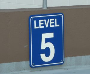 white 5 on blue field sign for level 5